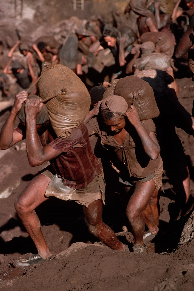 Gold Miners Carry Bags of Dirt